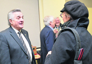 Marc-Aurèle-Fortin Liberal MP Yves Robillard, left, chats with a constituent during a consultation meeting held on Feb. 10 in preparation for the upcoming federal budget.
