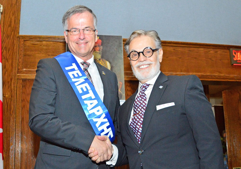 Chomedey Liberal MNA Guy Ouellette, left, is this year's Greek Independence Day Parade Marshall. HCGM president Nicholas T. Pagonis on the right.