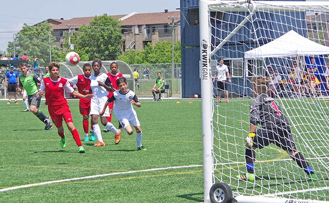 Photo: strikers for Team Quebec attempt to get one past the Ontario goalie.