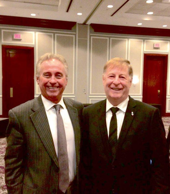 Tom Lukiwski, is seen here with Laval mayor Marc Demers