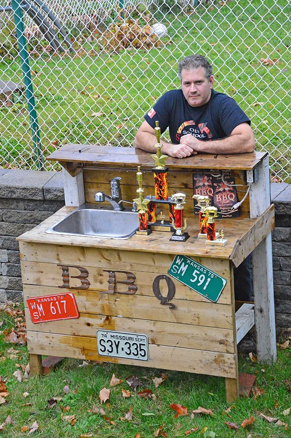 Manny Mavroudis with some of the trophies he's won in BBQ and smoking competitions
