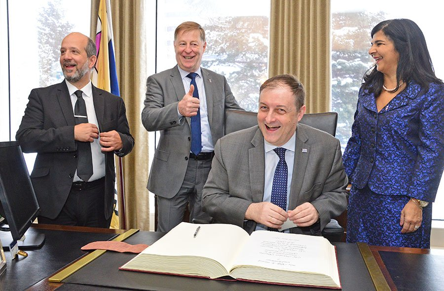 Greek Consul General in Montreal Nicolaos Sigalas signs the Golden Book at Laval city hall on March 25.