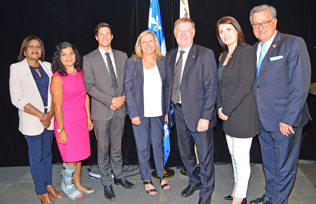 The members of the committee overseeing the FARR subsidies are (from the left) Laval city councillor Jocelyne Frédéric-Gauthier, Councillor Aglaia Revelakis, Councillor Stéphane Boyer, co-president Francine Charbonneau, co-president Mayor Marc Demers, Councillor Sandra Desmeules and Vimont MNA Jean Rouselle.