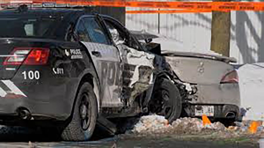Laval police officers injured after crashing into 4 parked cars